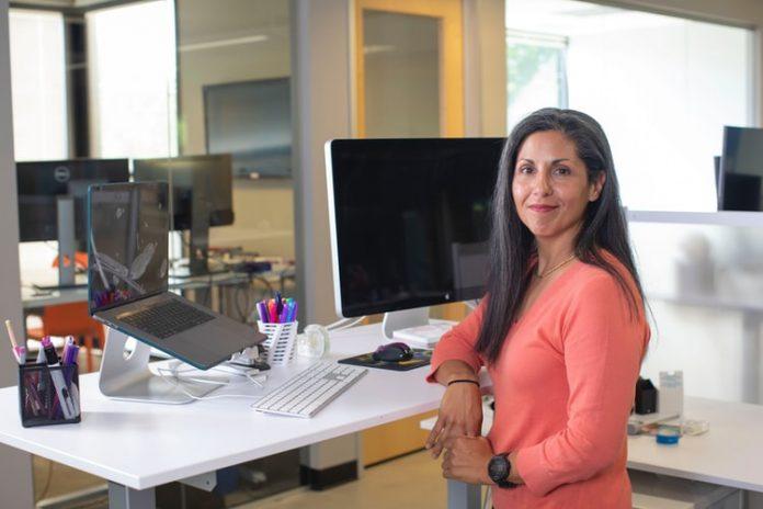 Woman using standing desk