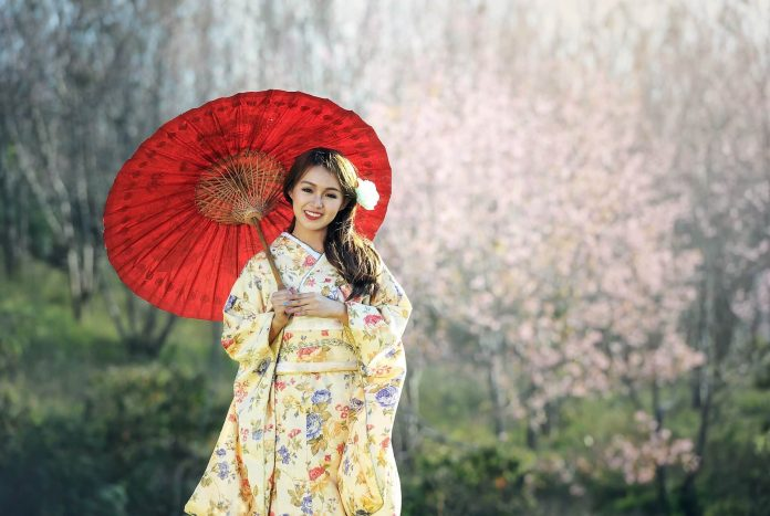 Lady holding a Japanese Umbrella