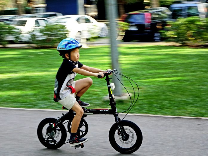 Baby riding a kids bike